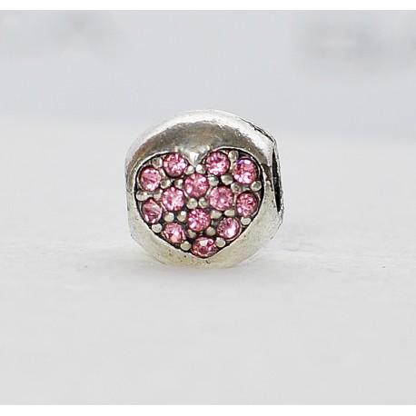 Karoliukas su širdele iš rožinių blizgučių
